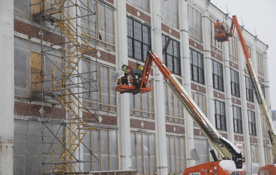 Project leaders celebrated aconstruction milestone: theinstallation of the first set of 156 replica historic windows. The windows are designed topreserve the look of the Niagara Machine and Tool Works building, which dates to 1911. (Derek Gee/Buffalo News)