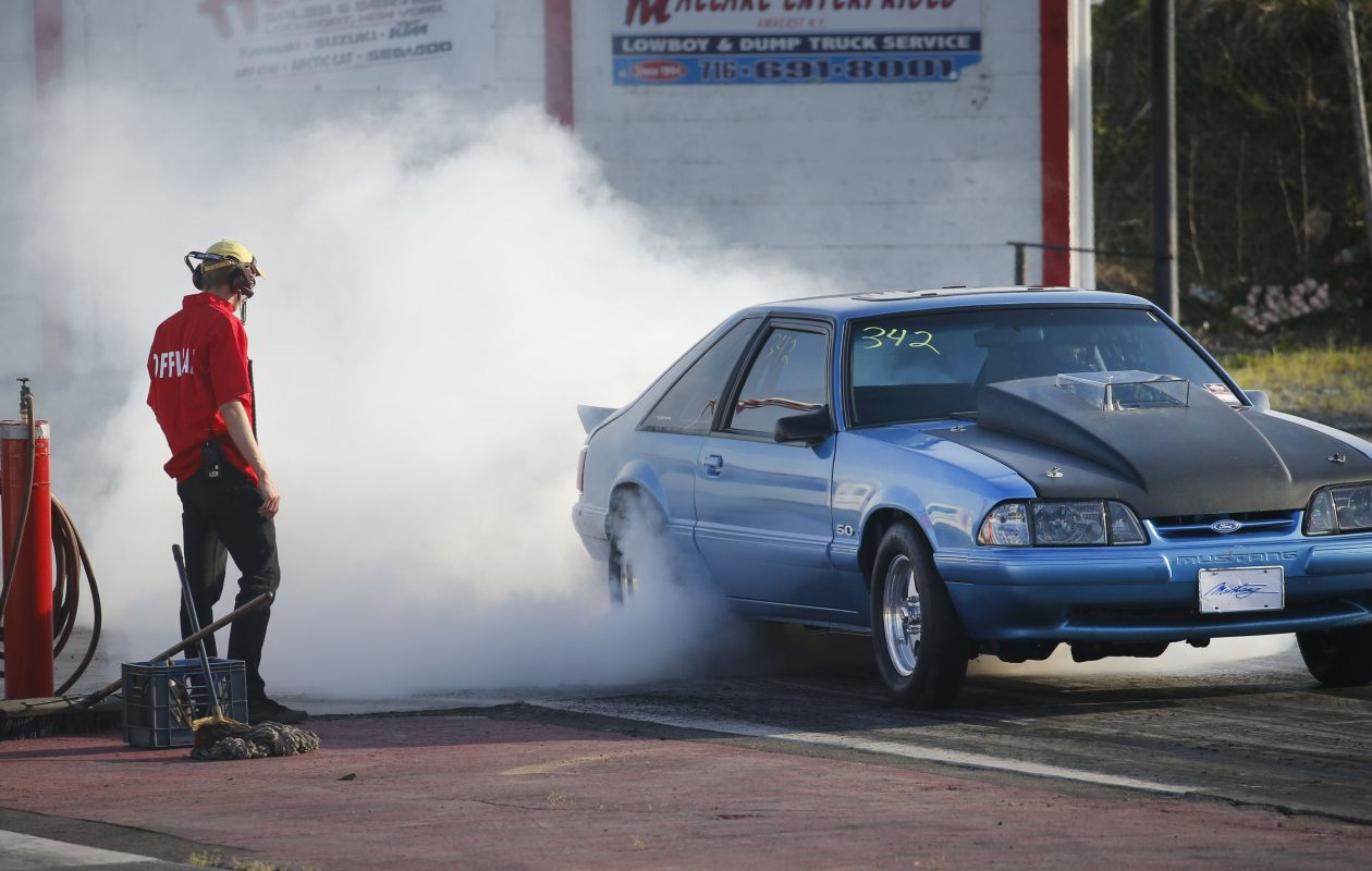 A Ford Mustang burns rubber – and makes  noise – before going to the starting line at Lancaster Speedway. (Robert Kirkham/News file photo)