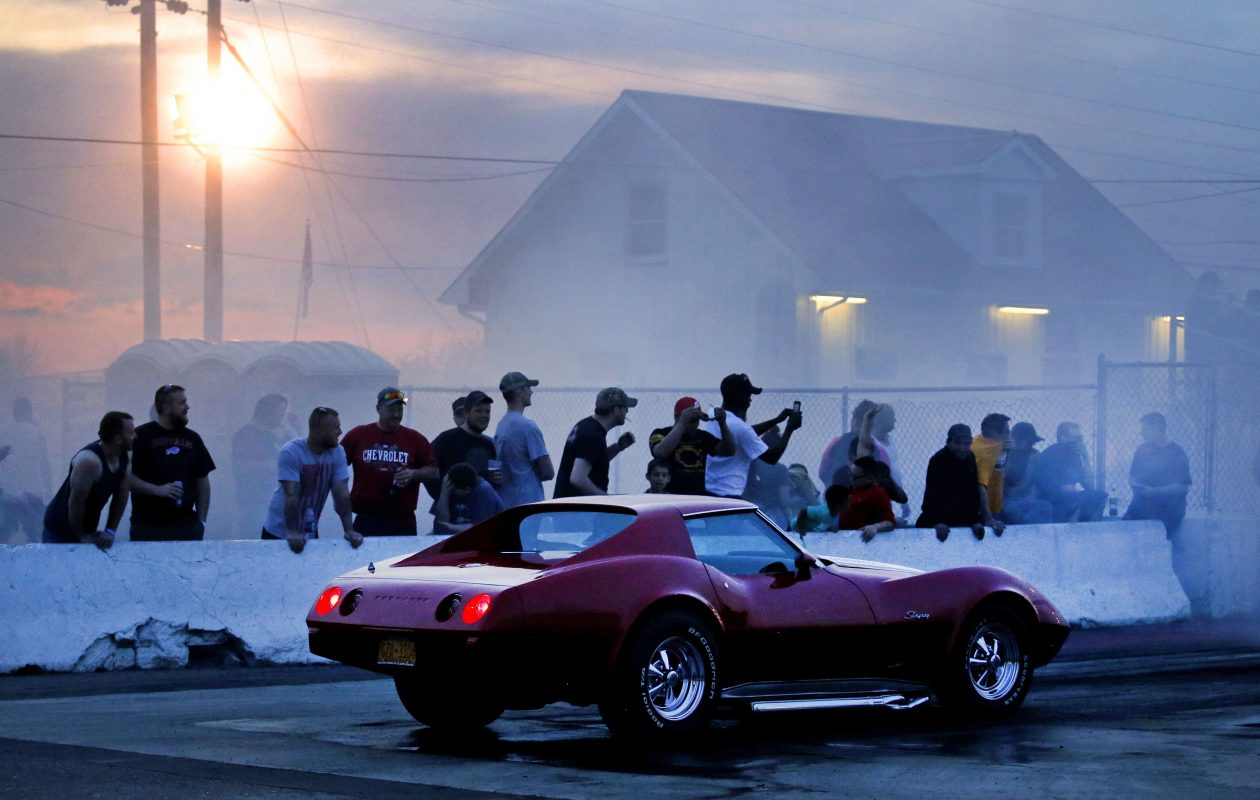 Fans watch as a Corvette Stingray approaches the starting line during the track's weekly Wednesday 'Cruise Night and Grudge Drags' at Lancaster National Speedway on Gunnville Road in Lancaster.  (Robert Kirkham/Buffalo News)