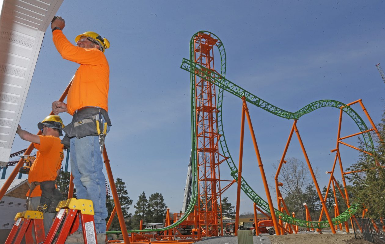 Head carpenter Don Hulme, right, and helper Alex Waldraff apply siding to the photo booth at the end of the ride.  Darien Lake's newest roller coaster called Tantrum was being installed and will go into operation in late May.  (Robert Kirkham/Buffalo News)