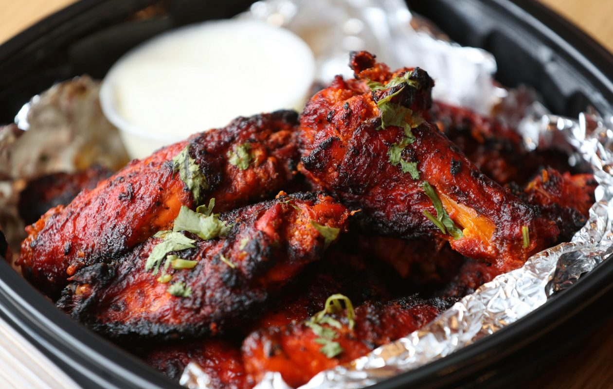 Alibaba Kebab's tandoori wings are marinated in tandoori spices and cooked in the clay oven without oil or grease.  (Sharon Cantillon/Buffalo News)