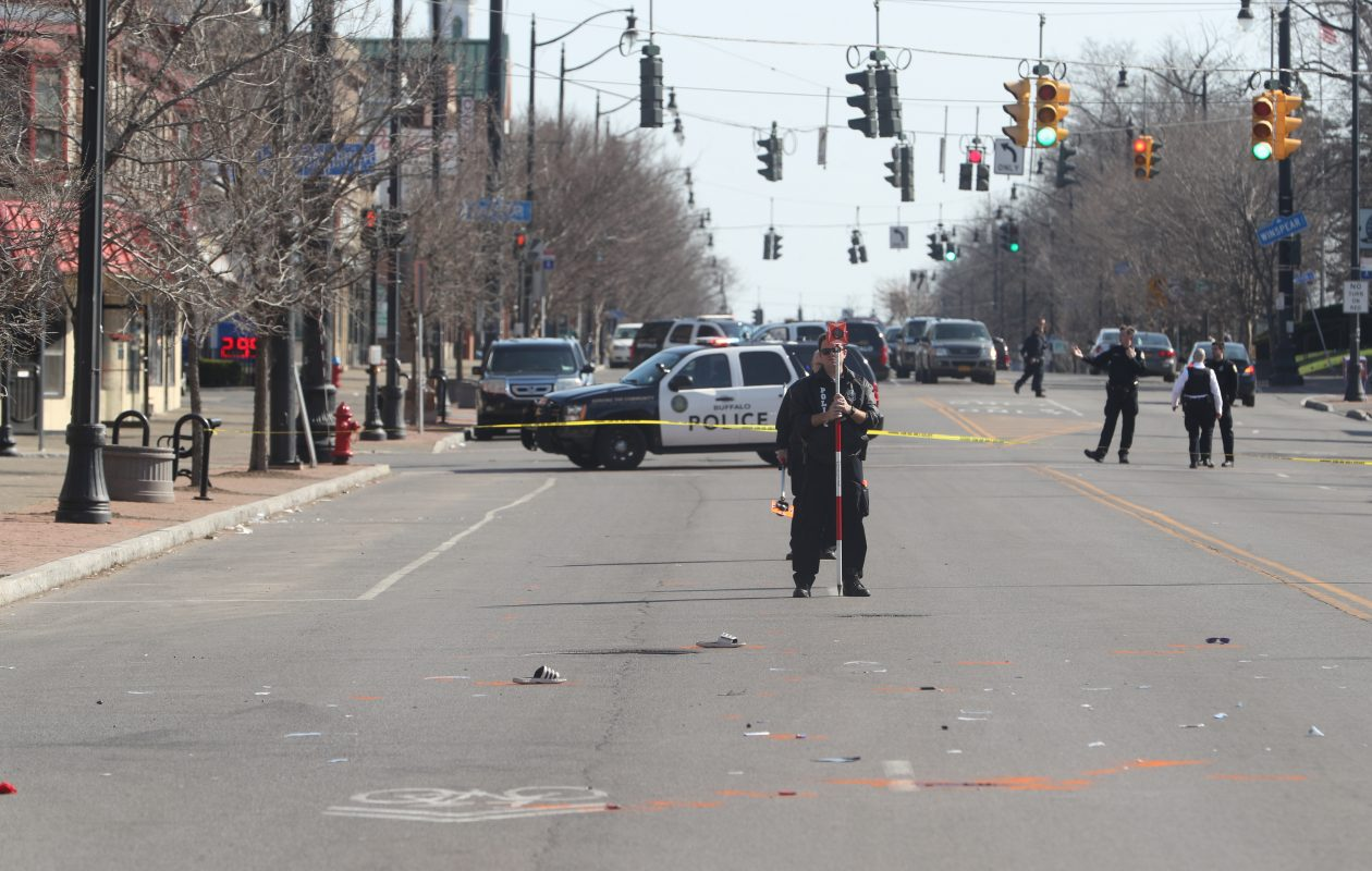 Buffalo police on the scene of the Main Street accident this morning. The victim, a UB student, was wearing flip flops at the time he was hit. (John Hickey/Buffalo News)
