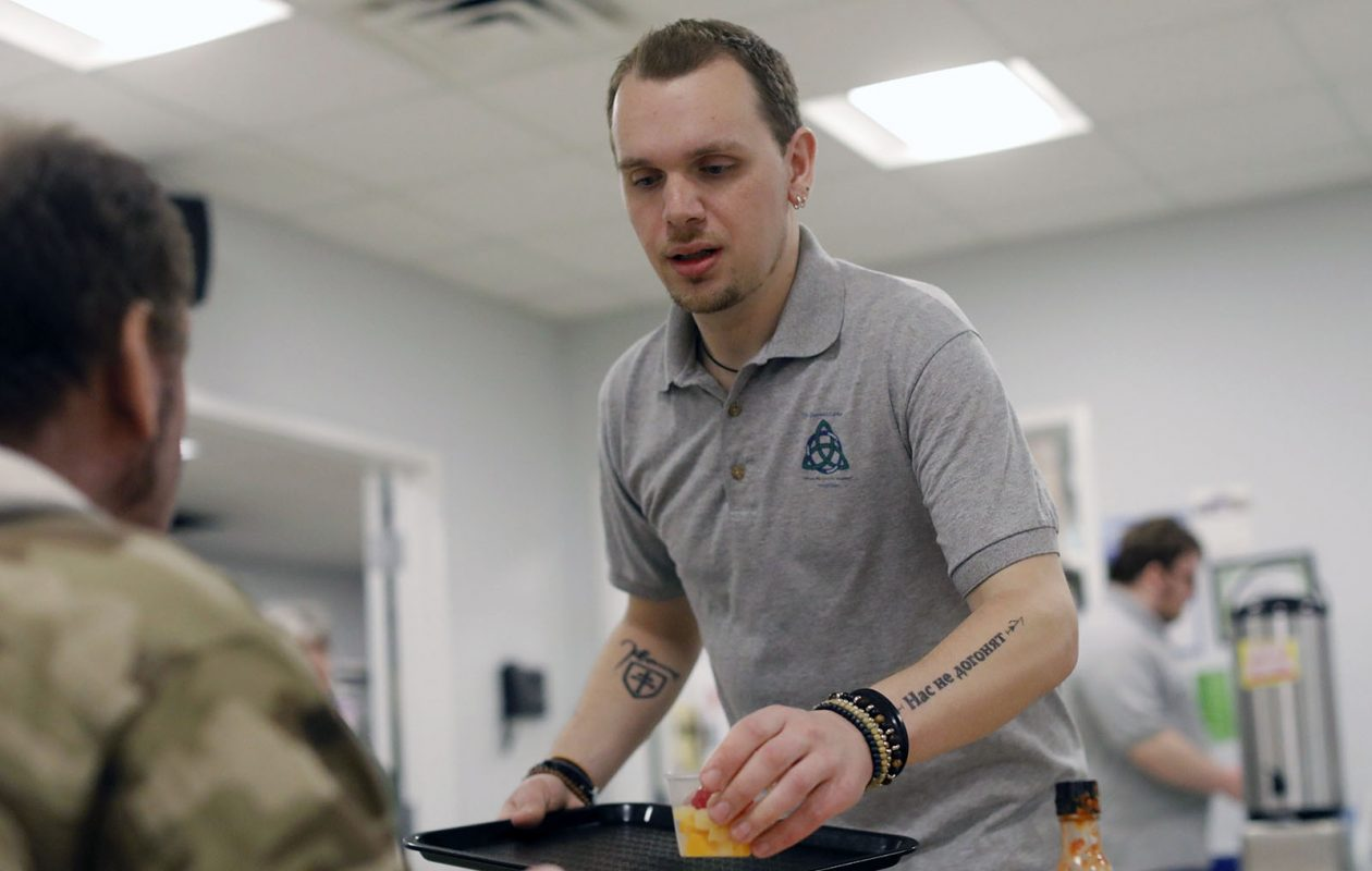 Ben Francis, who has remained clean for two and a half years after struggling with opioid addiction, volunteers as a server in the soup kitchen at the Genesis Center in South Buffalo. (Derek Gee/Buffalo News)