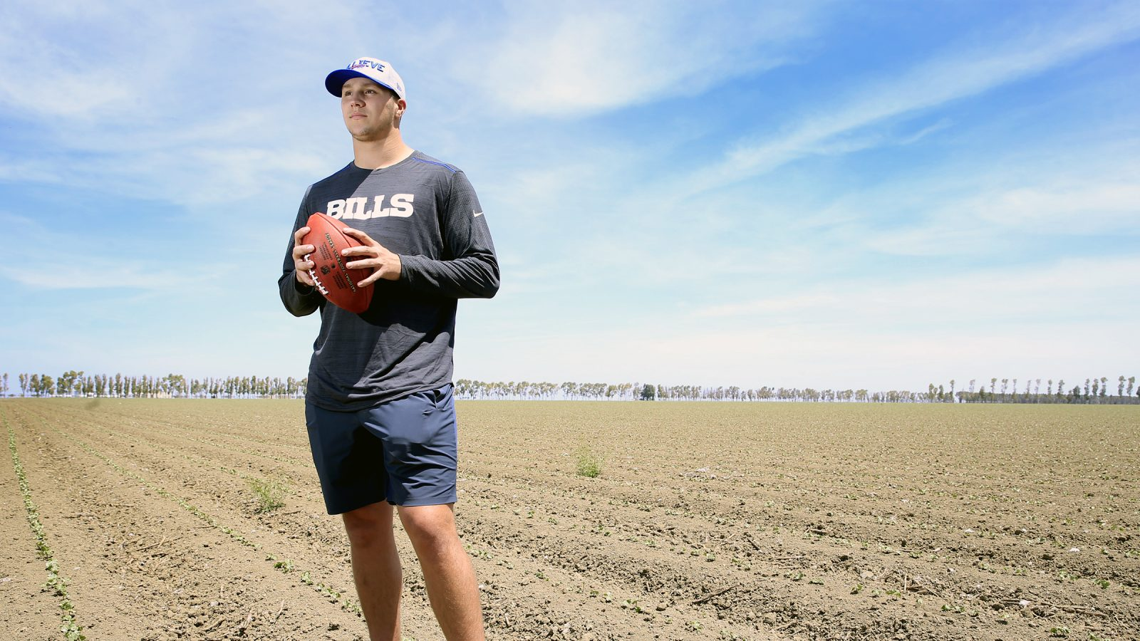 Josh Allen, the Bills' top 2018 draft pick, stands in the cotton fields at his family's farm in Firebaugh, Calif. (Harry Scull Jr./Buffalo News)