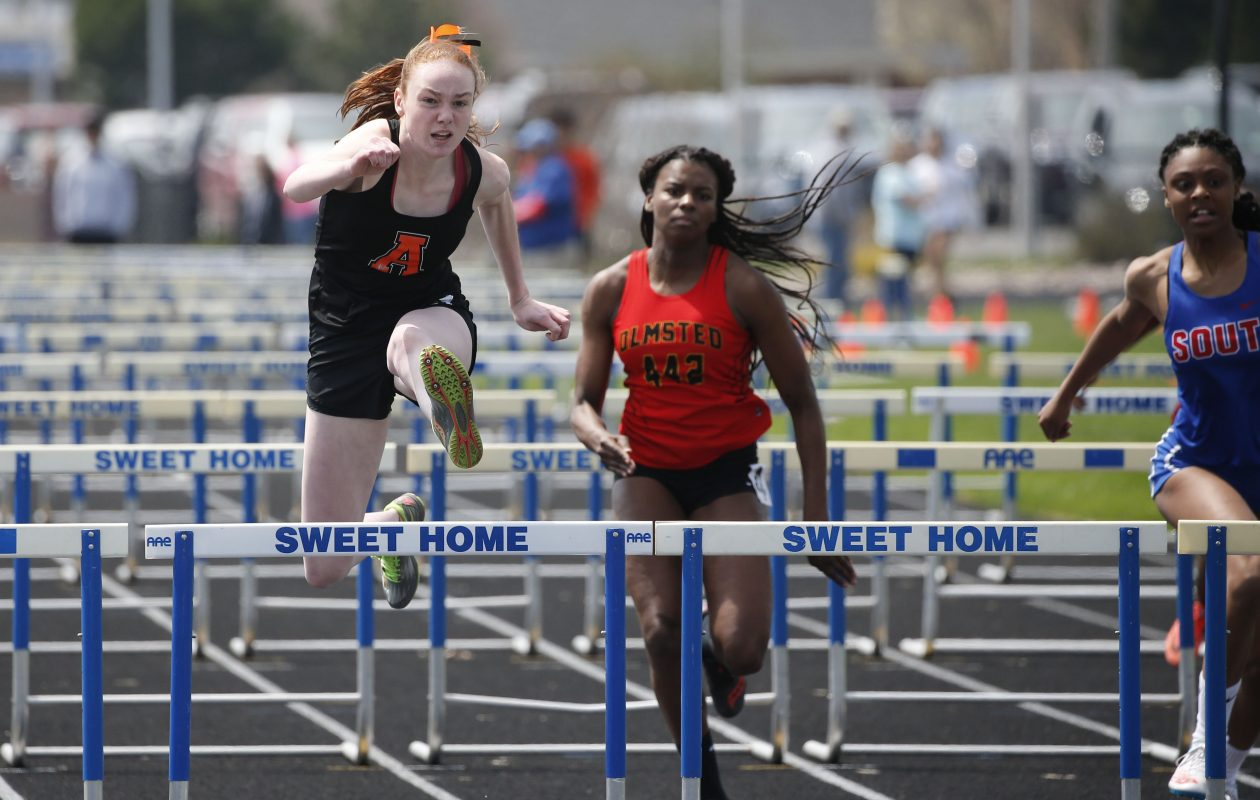 Morgan Halt of Amherst, left, won the 100 meter hurdles.  (Derek Gee/Buffalo News)