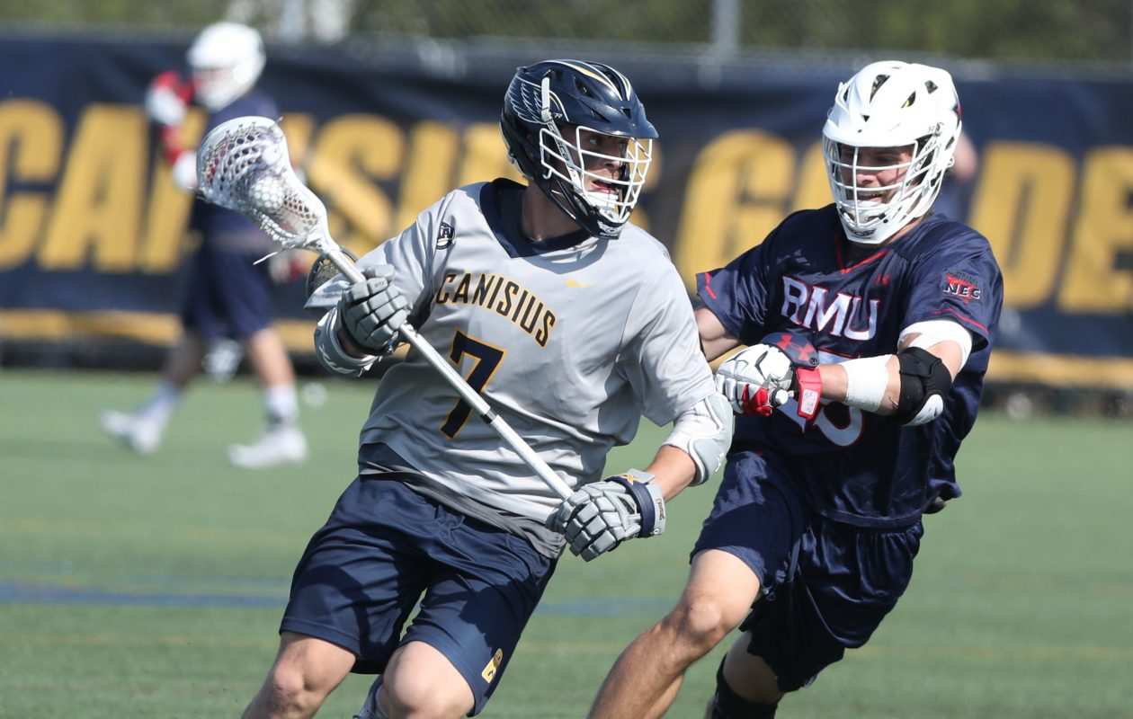 Carter Stefaniak of Canisius tries to get past Sean Doyle of Robert Morris in the first half of the Colonials' win Wednesday. (James P. McCoy/Buffalo News)