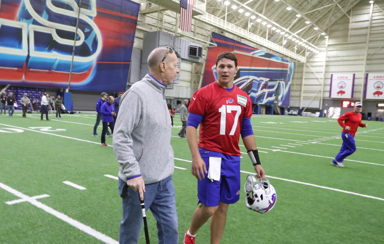 Bills Hall of Famer Jim Kelly talks to quarterback Josh Allen at rookie minicamp. (James P. McCoy/Buffalo News)