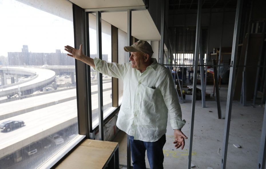 """""""We've been working inside all winter long doing what you're seeing now. It's not as if we've been standing still,"""" says One Seneca Tower owner Douglas Jemal, gesturing toward Canalside from inside the frame of an apartment. (Derek Gee/Buffalo News)"""