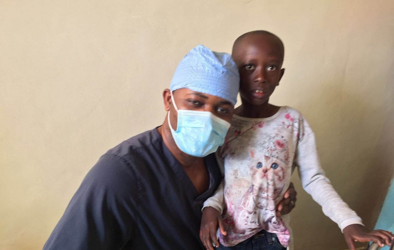 KC Suteh poses with a young patient at the Wellness Clinic, run by Buffalo-based Jericho Road Community Health Center, in Goma, Democratic Republic of Congo. (Courtesy of Dr. Myron Glick)