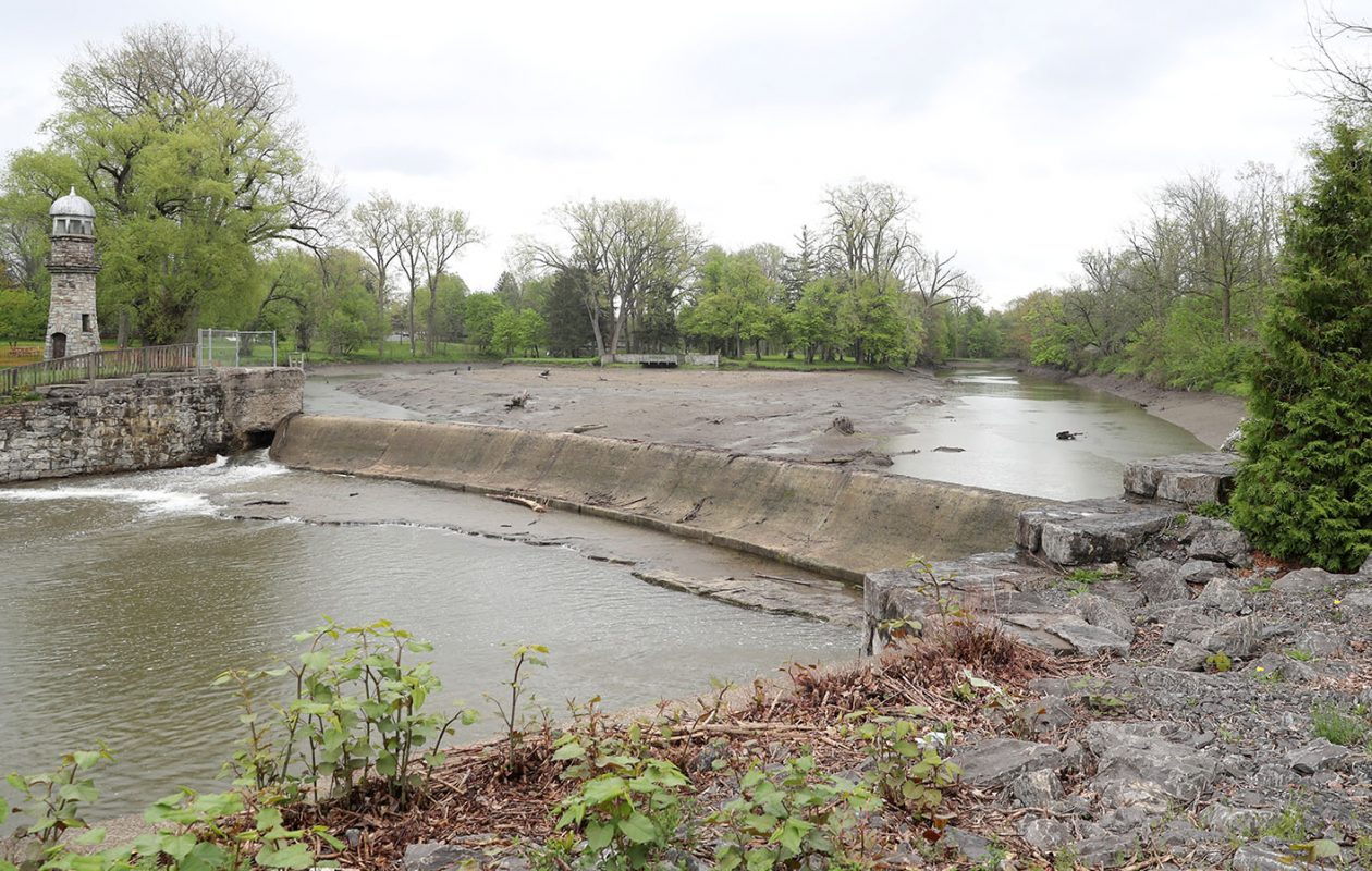 Phase one of remediation of Como Lake, underway now, calls for sediment testing and replacement of the dam gates. (John Hickey/Buffalo News)