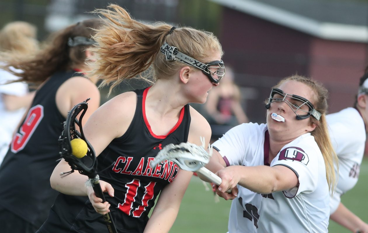 Morgan Baxendale of Orchard Park guards Gabby Eberle of Clarence. Baxendale provided most of the offense for OP, scoring eight times in the win. (James P. McCoy/Buffalo News)