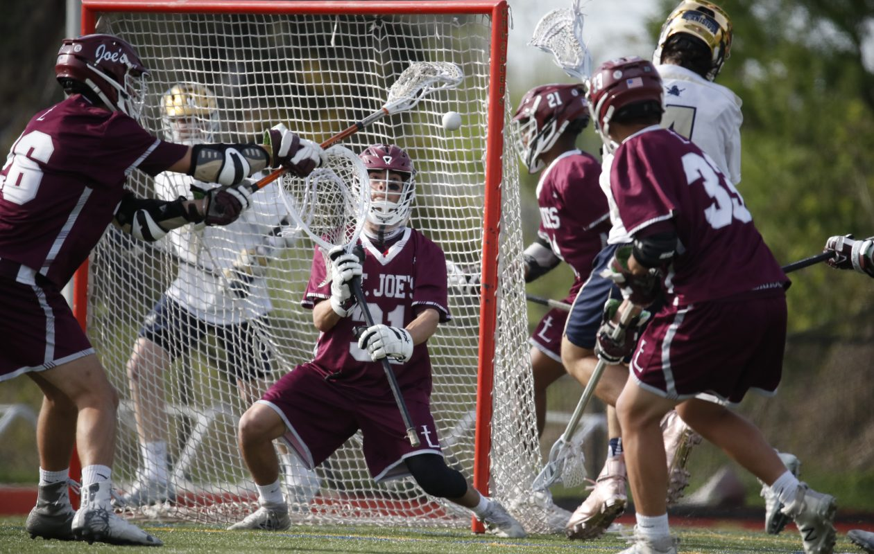 St. Joe's Jack Rapini makes a save against Canisius during the Marauders' 10-0 win at the Stransky Complex on Wednesday. (Harry Scull Jr./ Buffalo News)