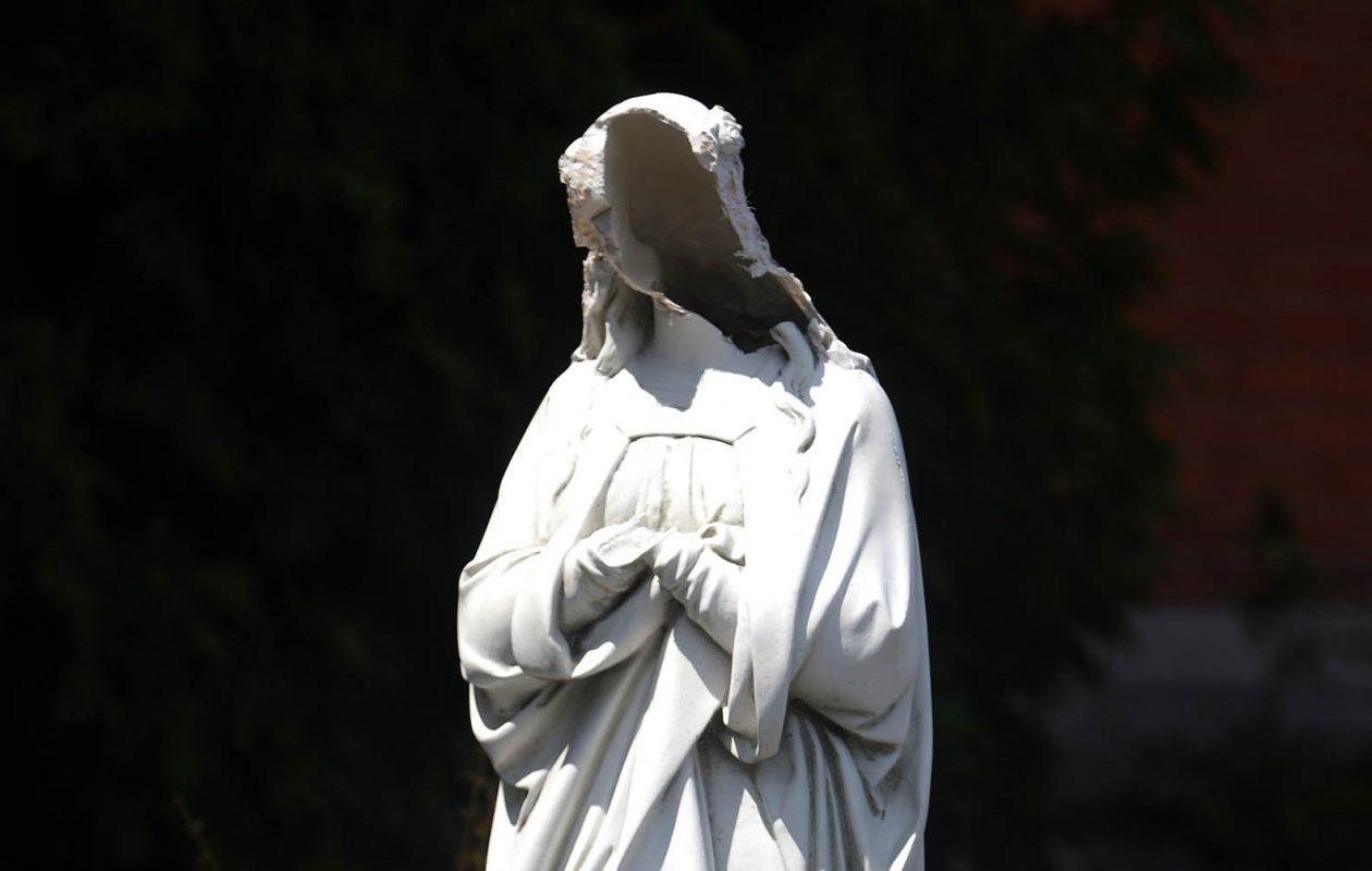 The vandalized statue of Mary at St. John Kanty Church in Buffalo. (John Hickey/News file photo)