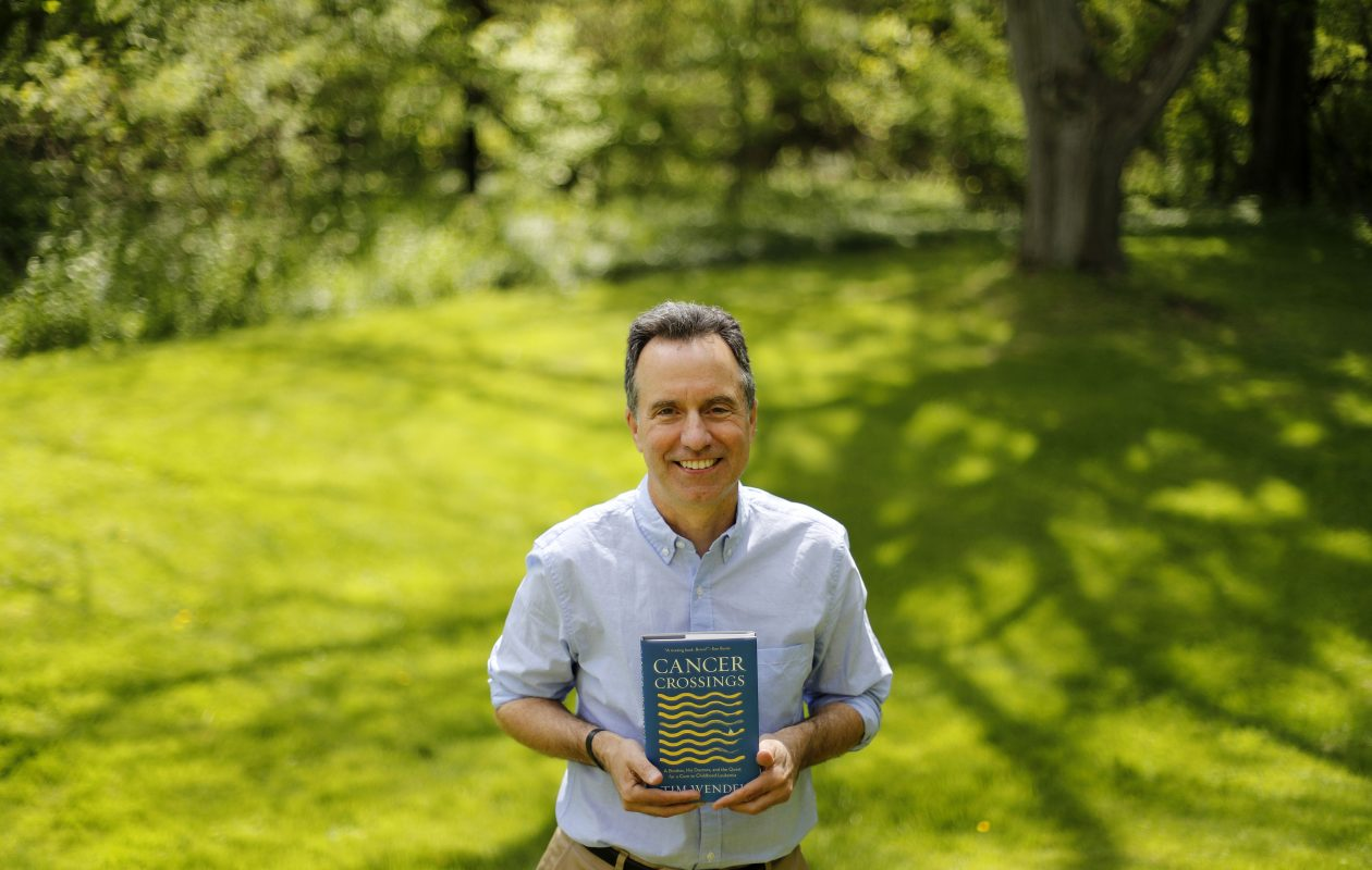 Author Tim Wendel at his parents' home in Lockport Friday. His book details both the passing of his brother Eric and the clinical victory over childhood cancer, much of it achieved in Buffalo.   (Mark Mulville/Buffalo News)