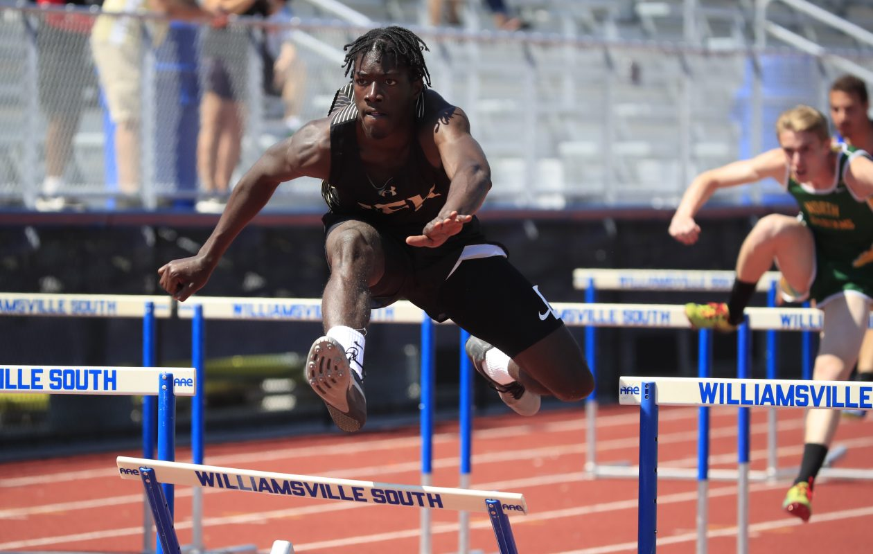 Shevaughn Allen from JFK posted the fastest qualifying time in the 110 hurdles. He also set a meet record in winning the long jump at the ECIC Championships at Williamsville South. (Harry Scull Jr./ Buffalo News)