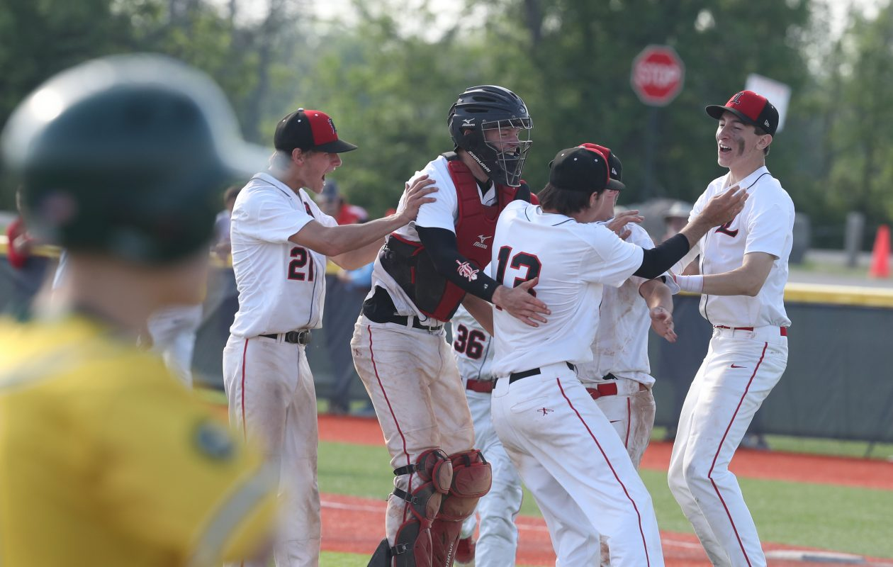 Lancaster celebrates after winning the Section VI Class AA championship on Saturday. The Legends are ranked first in the Western New York Coaches Baseball poll for large schools. (James P. McCoy/Buffalo News)