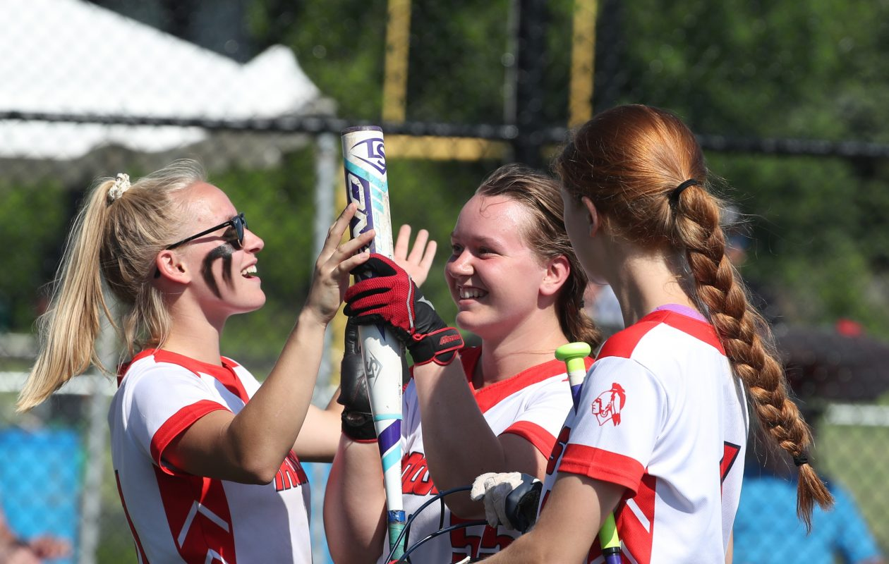 Iroquois Rachel Yax receives congratulations from her Chiefs teammates after scoring a run during Tuesday's Section VI Class A final against Williamsville East at Williamsville North Athletic Complex. (James P. McCoy/Buffalo News)