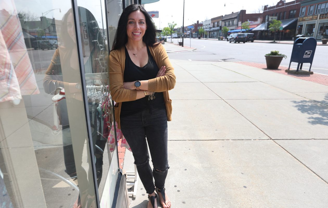 Stacey Moscato, owner of Peek-A-Boo Baby Boutique on Hertel Avenue, outside her shop. (Sharon Cantillon/Buffalo News)