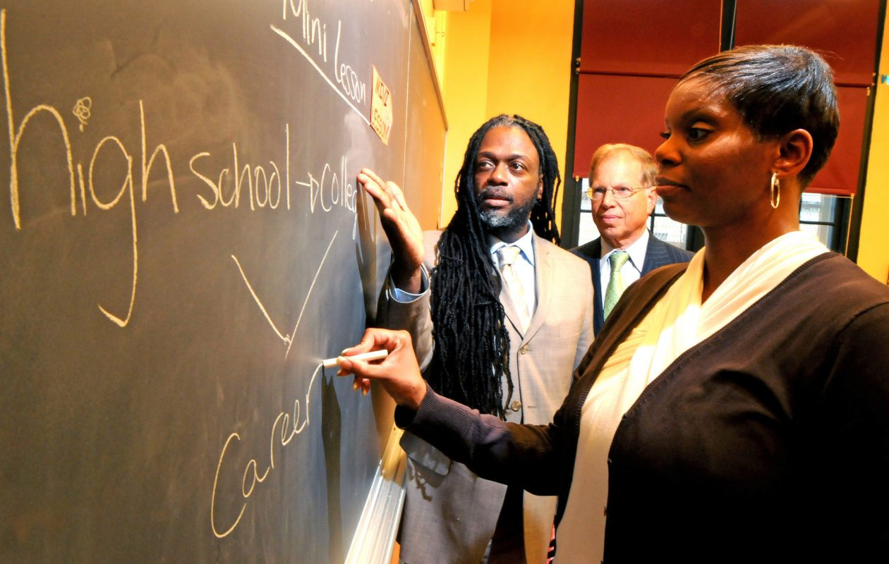 Teacher Tanya Spence, right, Principal Rashid d Davis, left, and IBM Foundation President Stanley Litow prepare for a class at Pathways in Technology Early College High School, a school in Brooklyn created by IBM that helps students attain the skills for careers in the technology industry.  (2013 photo by Bob Goldberg, Feature Photo Service for IBM)