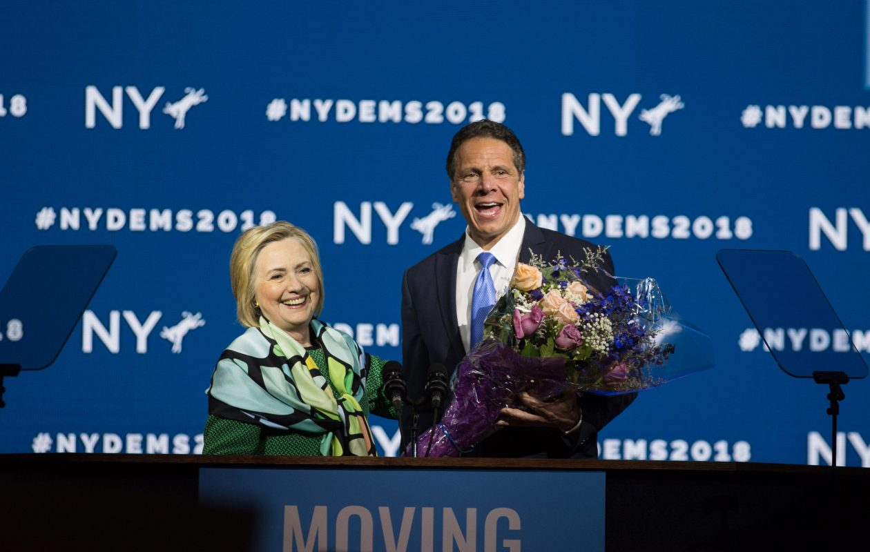 Gov. Andrew Cuomo brings flowers after Hillary Clinton's speech during the New York Democratic convention at Hofstra University on May 23, 2018. (Getty Images)