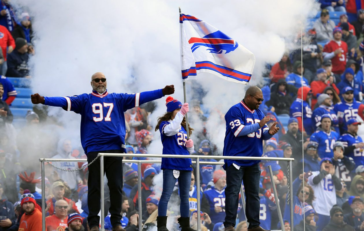 Bills alumni Cornelius Bennet and Sam Gash lead the charge before Buffalo played New England on Dec. 3, 2017. (Harry Scull Jr./News file photo)