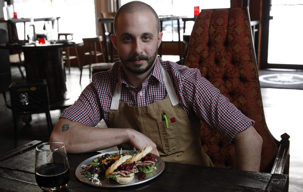 Black Iron Bystro owner and chef Bryan Mecozzi is pictured with duck sliders during his first year of business. Black Iron Bystro turns four on Tuesday. (Sharon Cantillon/News file photo)