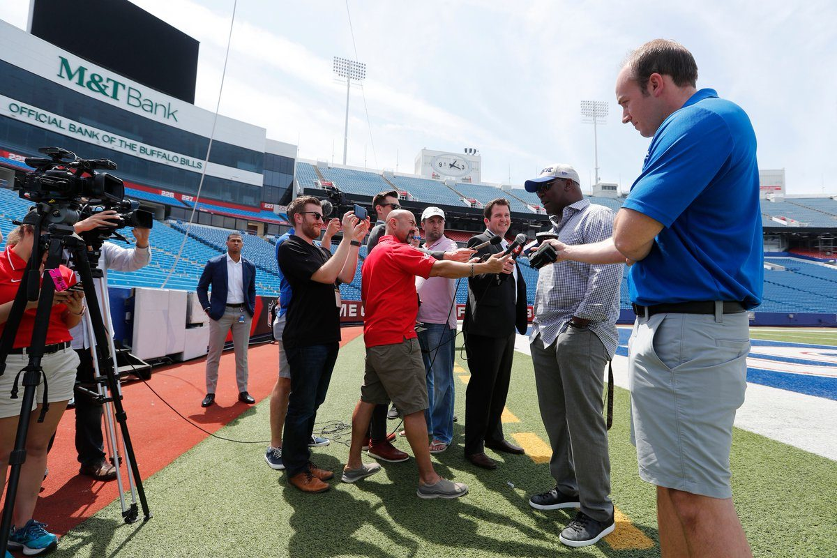 From left, reporters Matthew Fairburn, Joe Buscaglia, Sal Capaccio, Jay Skurski, Josh Reed and Jon Scott interview Thurman Thomas at New Era Field. (Mark Mulville/Buffalo News)