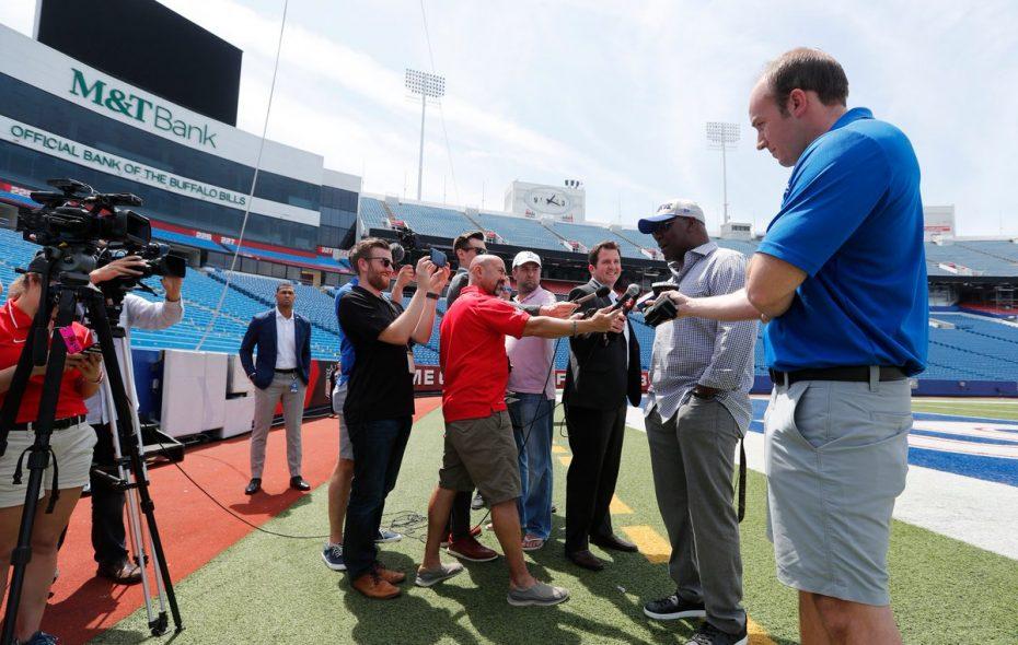 From left, reporters Matthew Fairburn, Joe Buscaglia, Sal Capaccio, Jay Skurski, Josh Reed and Jon Scott interview Thurman Thomas at New Era Field. (Mark Mulville/Buffalo News)
