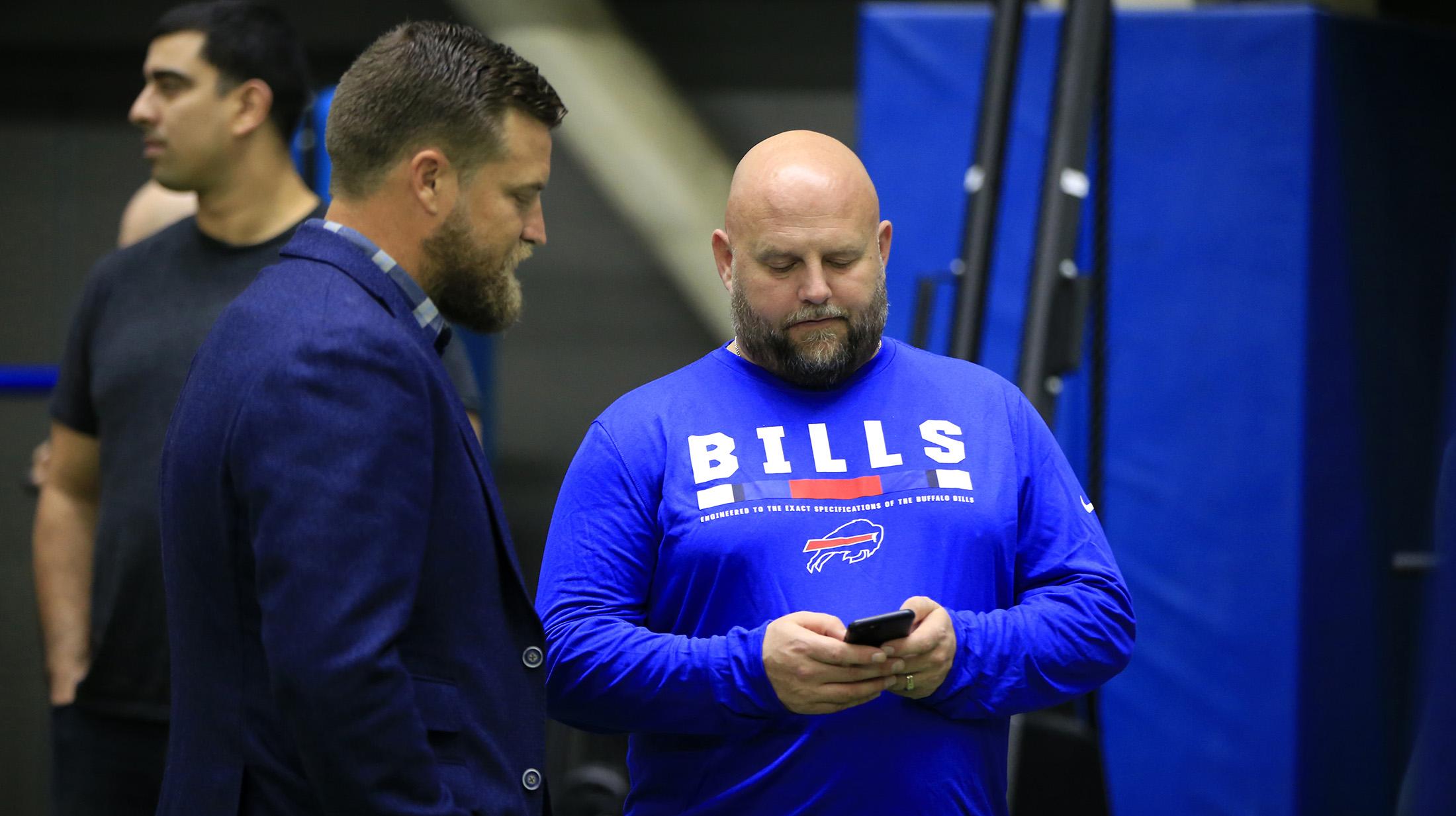Bills OC Brian Daboll talks to former QB Ryan Fitzpatrick on Jan. 29. (Harry Scull Jr./News file photo)