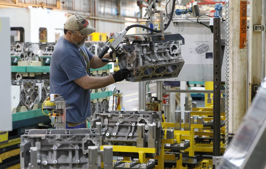 A worker loads engine blocks onto the Gen 5 line at the GM Tonawanda Engine Plant on Monday, May 21, 2018. GM announced that workers at the Tonawanda plant would build a new line of fuel efficient engines for the 2019 Silverado pickup trucks.  (Derek Gee/Buffalo News)