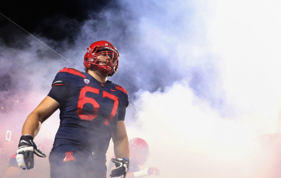 Offensive lineman Gerhard de Beer #67 of the Arizona Wildcats runs out onto the field before the college football game against the Oregon State Beavers at Arizona Stadium on November 11, 2017 in Tucson, Arizona.  (Photo by Christian Petersen/Getty Images)