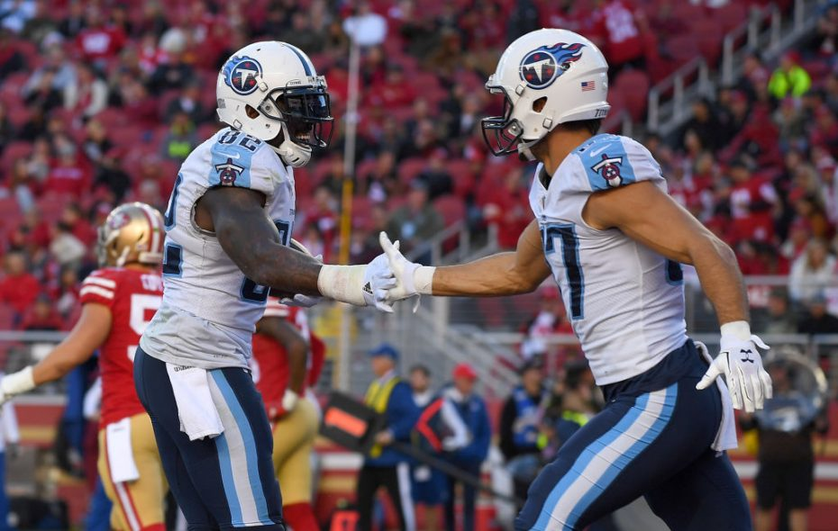 Delanie Walker #82 and Eric Decker #87 of the Tennessee Titans celebrate after Walker caught a touchdown pass against the San Francisco 49ers during their NFL football game at Levi's Stadium on December 17, 2017 in Santa Clara, California.  (Photo by Thearon W. Henderson/Getty Images)
