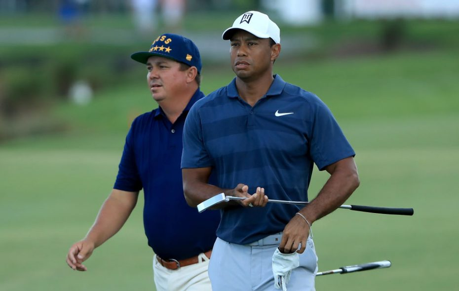 Jason Dufner and Tiger Woods couldn't be further apart in their approach to golf. (Getty Images)