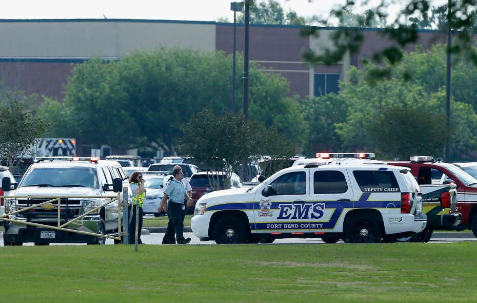 Emergency medical personnel  in the Santa Fe High School parking lot where 10 people were shot and killed on May 18, 2018 in Santa Fe, Texas. (Getty Images)