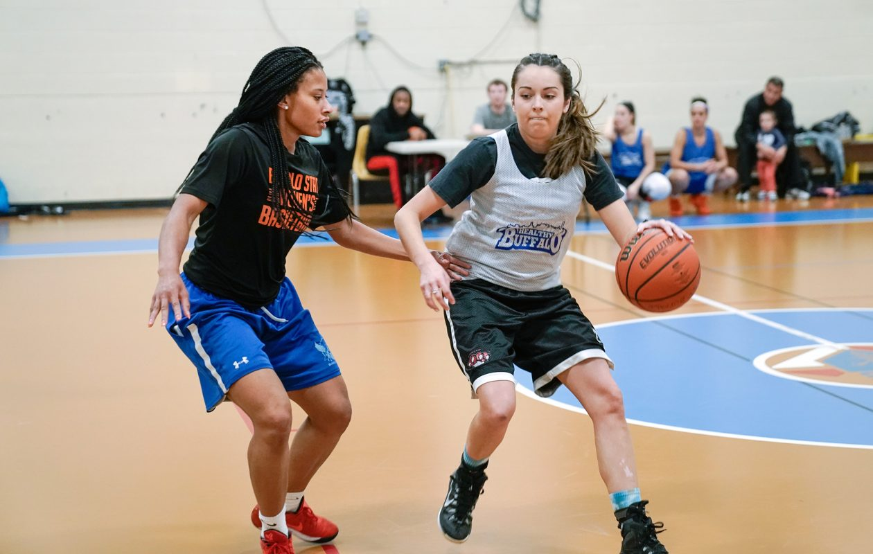 Britnee Perry, left, and Amber Hay face off in a Healthy Buffalo league basketball game. (Dave Jarosz)