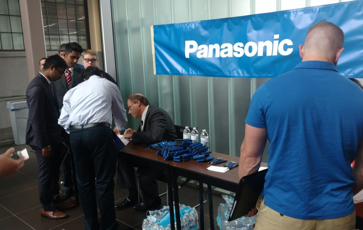 Workers register at a Panasonic career fair in July 2017 for job openings at its portion of the Tesla solar panel factory in South Buffalo. (David Robinson/Buffalo News)
