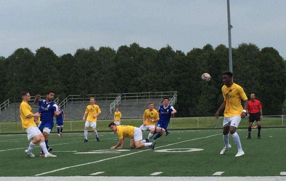 FC Buffalo's Isaiah Wilson settles the ball as his teammate, Jake Cooper, takes a tumble. (Ben Tsujimoto/Buffalo News)