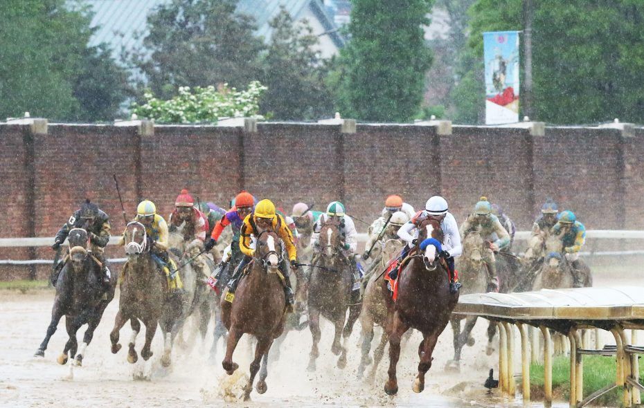 Justify takes charge around the quarter pole at the Kentucky Derby. Photo Credit: Churchill Downs/Coady Photography