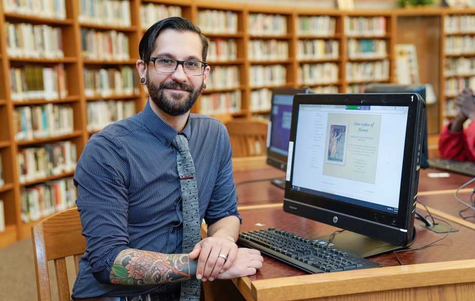 After a stint in construction work, Joshua Mitch found his life's passion as a librarian. (Dave Jarosz)