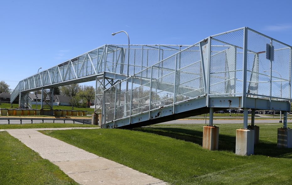 The closed Sheridan Drive pedestrian bridge, between Delaware Avenue and Colvin Boulevard, in Town of Tonawanda, is coming down this coming week.  (John Hickey/News file photo)