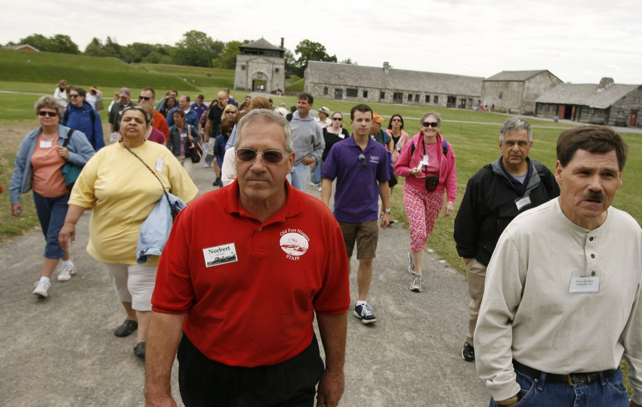The Rev. Norbert Orsolits, at center in red shirt, volunteers as a docent on a tour of Old Fort Niagara in Youngstown on July 13, 2009. Orsolits told The Buffalo News he had sexual contact with probably dozens of teen boys while serving as a Buffalo Diocese priest. (Buffalo News file photo)