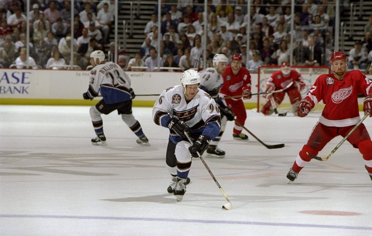 Phil Housley pursues the puck while playing for the Capitals in Game 3 of the 1998 Stanley Cup final against Detroit. (Getty Images)