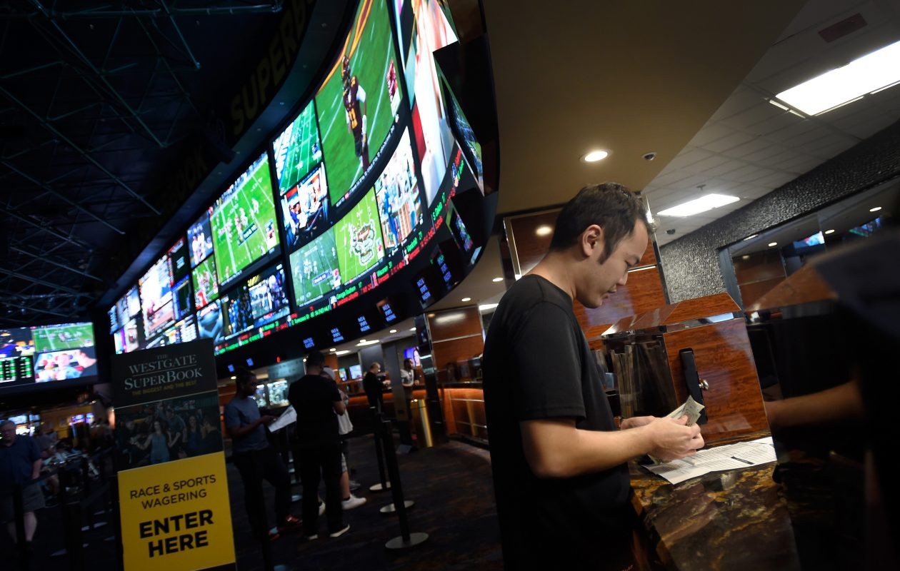 A customer makes a sports bet at the Race & Sports SuperBook in Las Vegas.(Washington Post file photo)