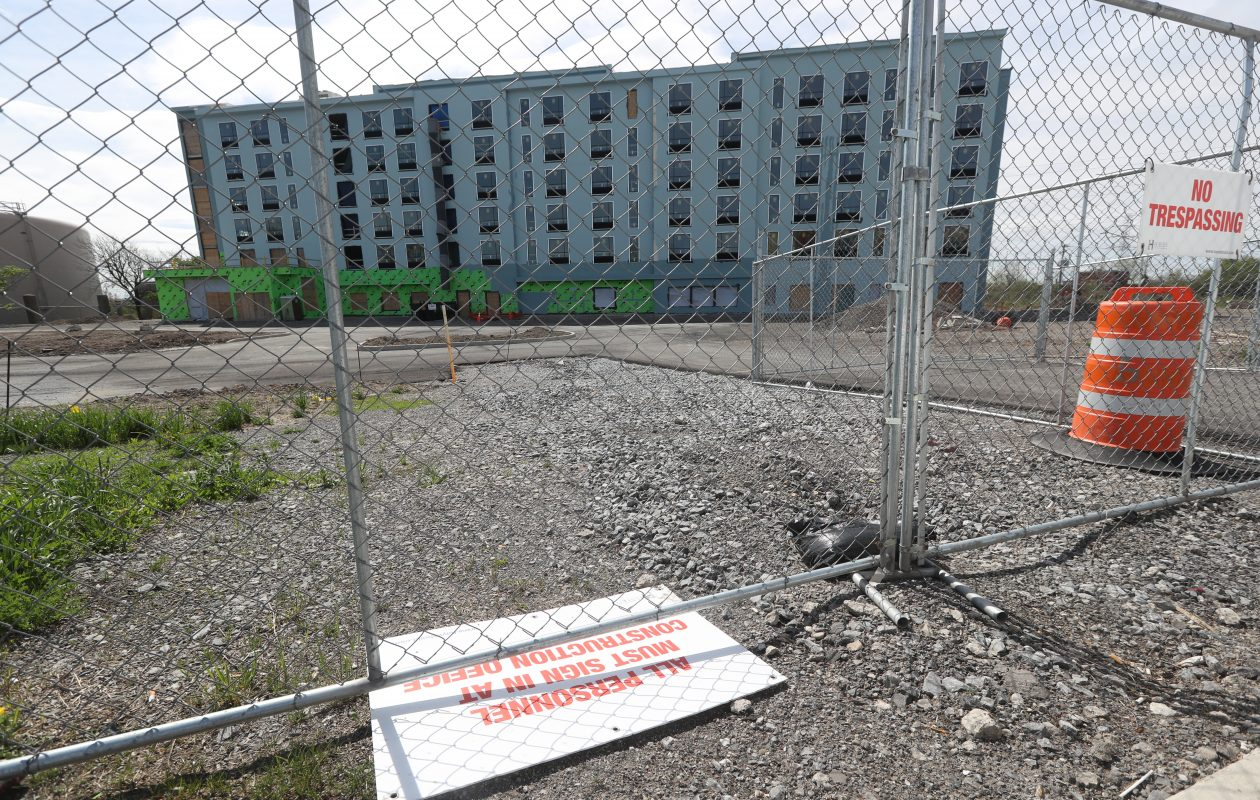 The six-story, partly finished hotel where work halted earlier this year, shown in May. Construction on the buliding exterior restarted a few weeks ago. (John Hickey/Buffalo News file photo)