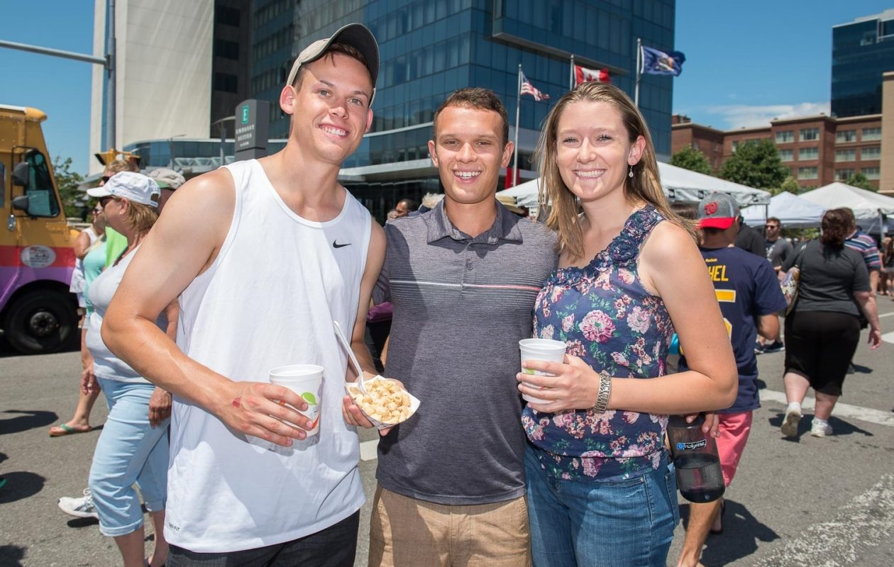Smiling faces at the 2017 Taste of Buffalo on Delaware Avenue and Niagara Square. (Matt Weinberg/Special to The News)