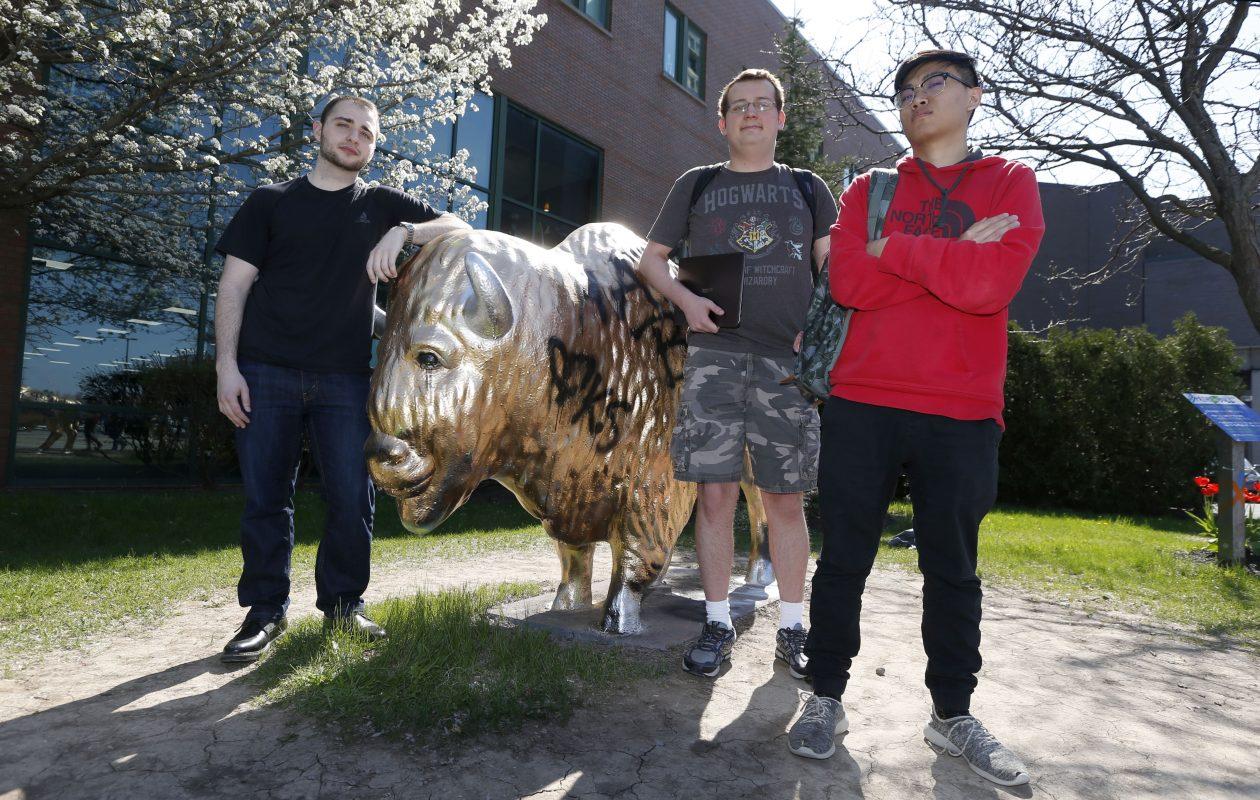 UB students, from left, Marc Coiro, 22, of Brooklyn; Robert Sands III, 20, of Orchard Park; and Allen Hu, 19, of Queens. (Robert Kirkham/Buffalo News)