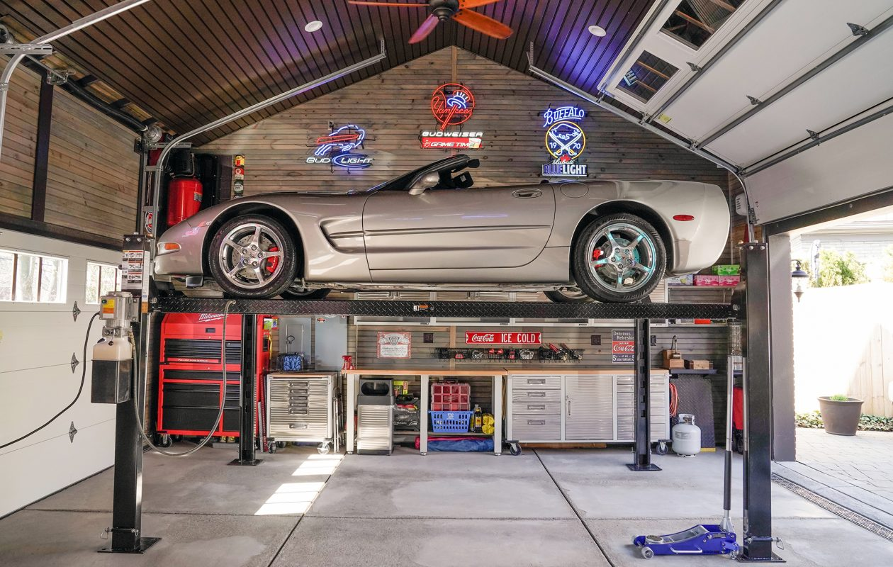 Dr. Vincent Fiorella's North Buffalo garage combines a car lift, snazzy storage cabinets and bar/kitchen set-up for a space that completely maximizes function — and fun. (Dave Jarosz)