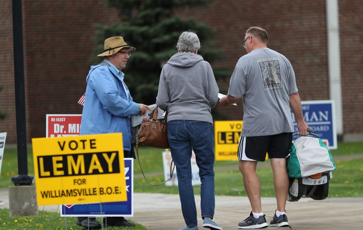 Voters come out for Williamsville School board and budget elections at Williamsville North High School. Candidate Robert Campo greets voters.  (Sharon Cantillon/Buffalo News)