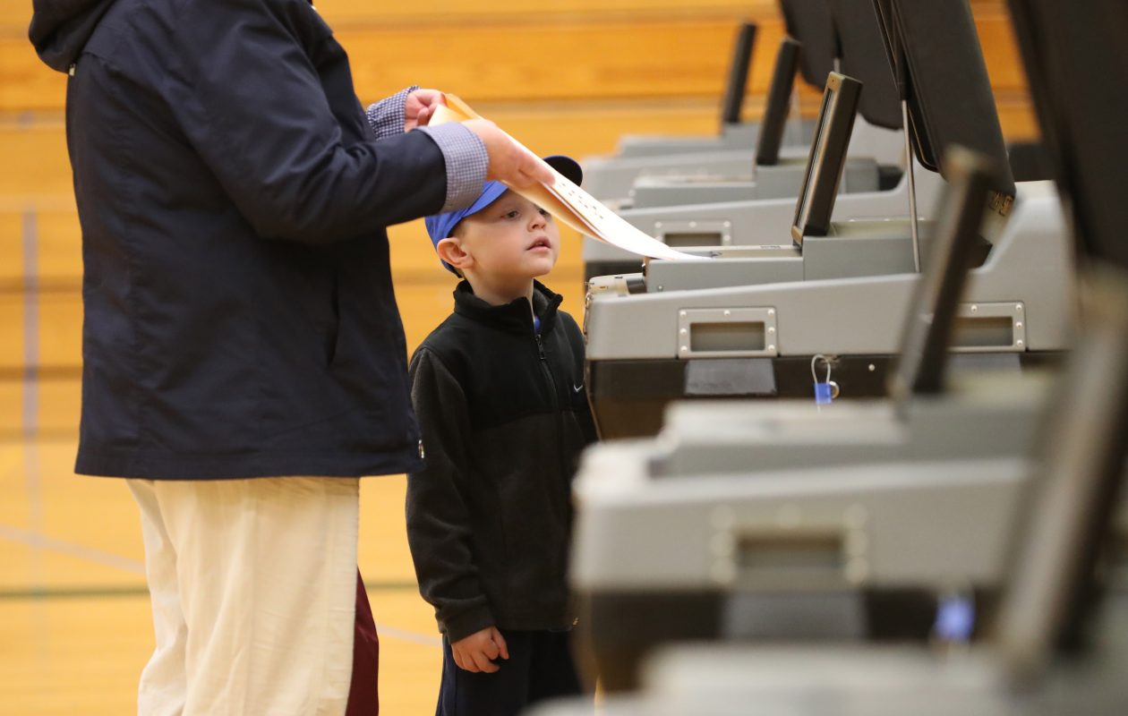 Jake Buesink, 5, watches as his grandmother Barb Burgstahler votes in Williamsville School District School Board and budget elections. (Sharon Cantillon/News file photo)