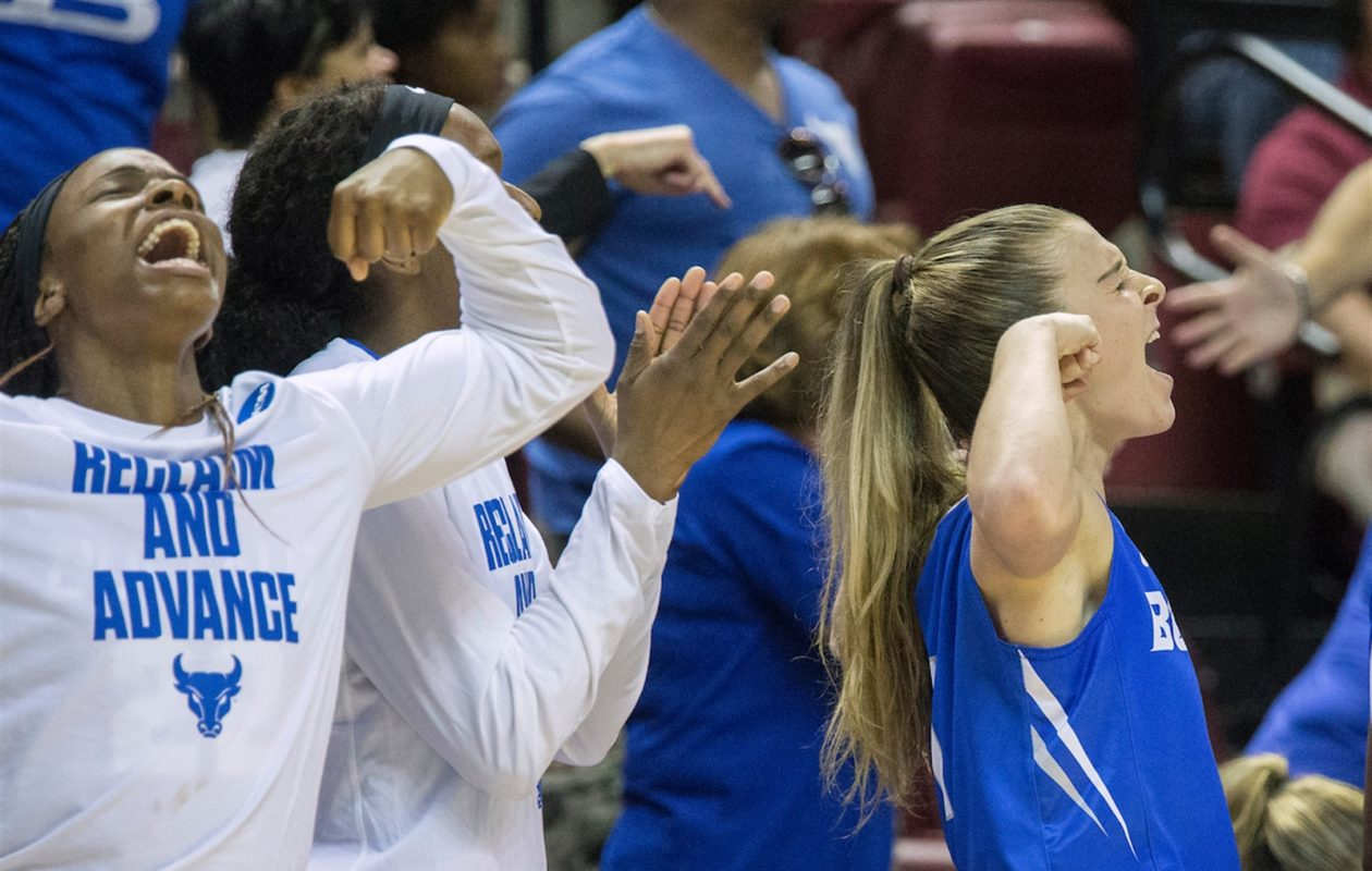 Buffalo guard Stephanie Reid, right, and teammates react to a shot in the second half of the Bulls' 86-65 victory against Florida State in the second round of the NCAA Tournament. (Mark Wallheiser/University at Buffalo)